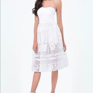 Jumpsuit shorts with lace dress overlay.